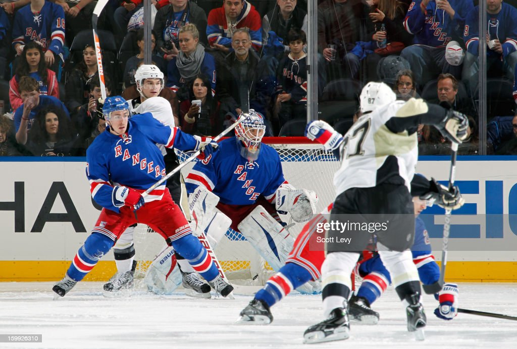 Martin Biron #43 of the New York Rangers protects the net against Sidney Crosby #87 of the Pittsburgh Penguins at Madison Square Garden on January 20, 2013 in New York City. The Penguins defeat the Rangers 6-3.
