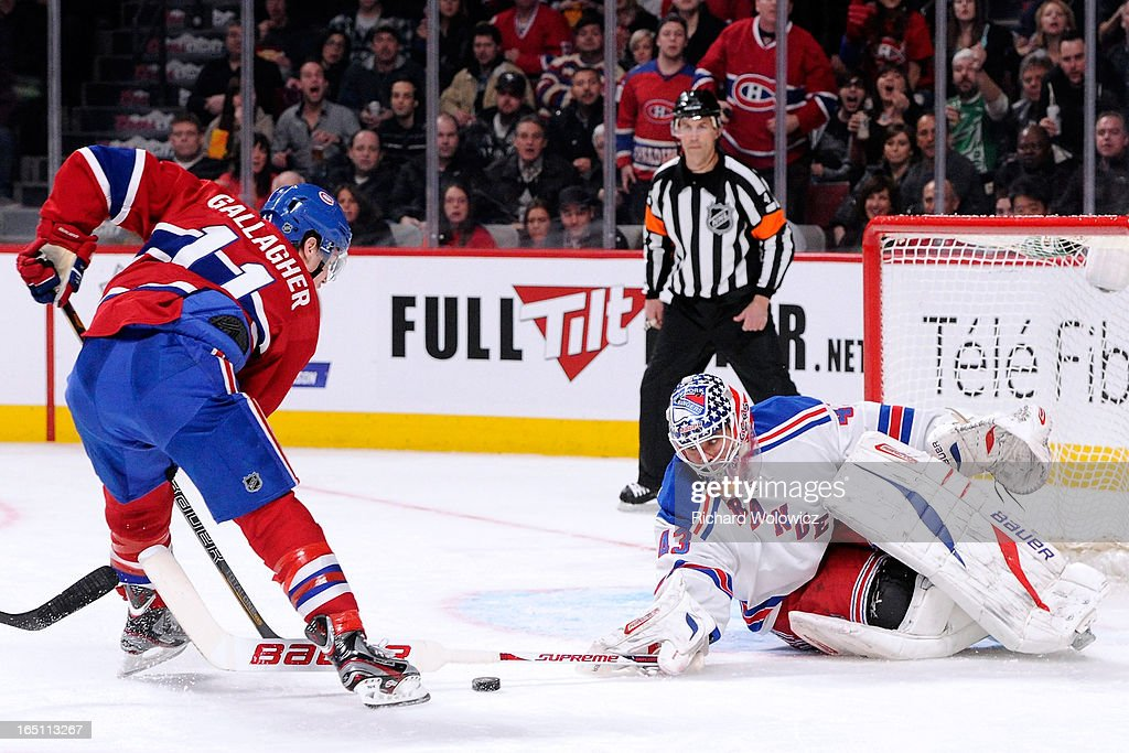 Martin Biron #43 of the New York Rangers stops the puck on an attempt by Brendan Gallagher #11 of the Montreal Canadiens during the NHL game at the Bell Centre on March 30, 2013 in Montreal, Quebec, Canada.