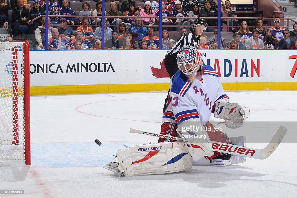 <a gi-track='captionPersonalityLinkClicked' href=/galleries/search?phrase=Martin+Biron&family=editorial&specificpeople=203146 ng-click='$event.stopPropagation()'>Martin Biron</a> #43 of the New York Rangers watches the shot of Ben Eager #55 (not pictured) of the Edmonton Oilers fly past him during a preseason NHL game at Rexall Place on September 24, 2013 in Edmonton, Alberta, Canada.
