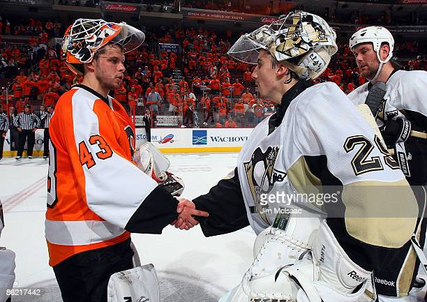 Martin Biron of the Philadelphia Flyers congratulates MarcAndre Fleury of the Pittsburgh Penguins after Game Six of the Eastern Conference...