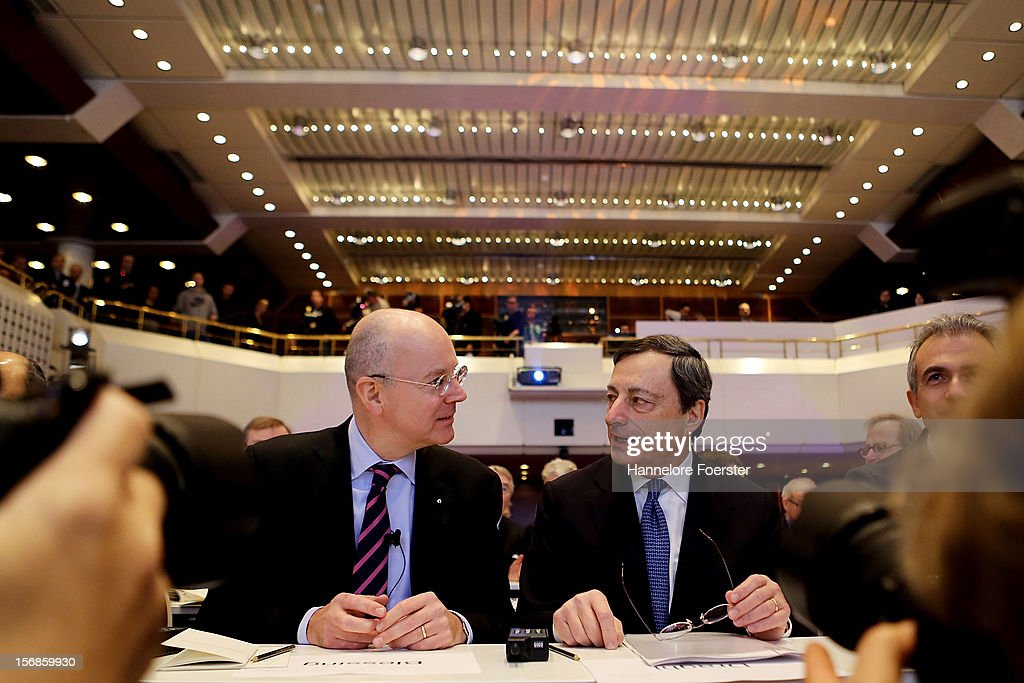 Martin Blessing, chairman of the managment board of Commerzbank AG, (L) and <a gi-track='captionPersonalityLinkClicked' href=/galleries/search?phrase=Mario+Draghi&family=editorial&specificpeople=571678 ng-click='$event.stopPropagation()'>Mario Draghi</a>, president ECB attend the European Banking Congress, on November 23, 2012 in Frankfurt am Main, Germany.