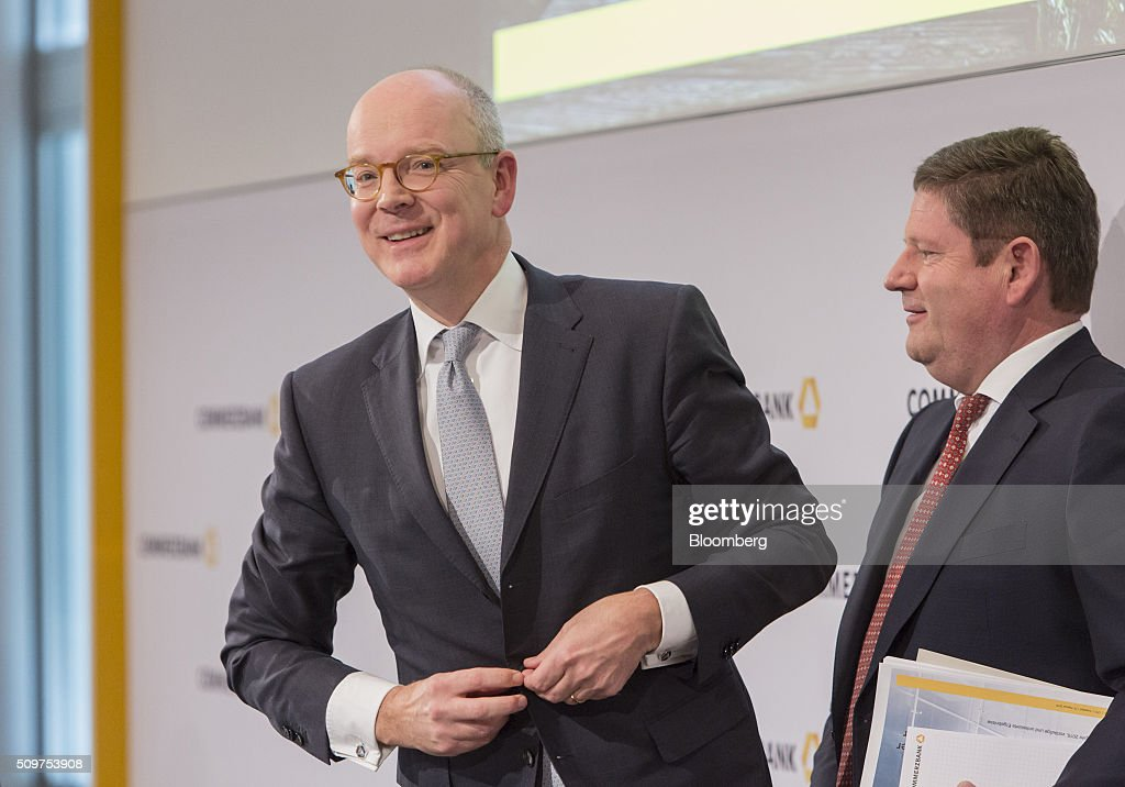 <a gi-track='captionPersonalityLinkClicked' href=/galleries/search?phrase=Martin+Blessing&family=editorial&specificpeople=4891922 ng-click='$event.stopPropagation()'>Martin Blessing</a>, chief executive officer of Commerzbank AG, left, buttons his jacket as Stephan Engels, chief financial officer of Commerzbank AG, looks on following during a news conference to announce the bank's earnings in Frankfurt, Germany on Friday, Feb. 12, 2016. Commerzbank jumped the most in more than two years after fourth-quarter profit beat analyst estimates, as the lender said it plans to wind down its unit for soured loans at a faster pace than forecast. Photographer: Martin Leissl/Bloomberg via Getty Images