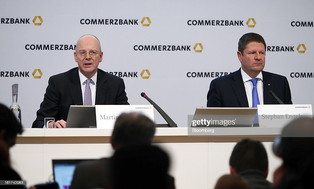 Martin Blessing, chief executive officer of Commerzbank AG, left, speaks as Stephan Engels, chief financial officer of Commerzbank AG, listens during a news conference in Frankfurt, Germany, on Friday, Feb.15, 2013. Blessing gave up his bonus for last year and cut the payouts by an average 17 percent across the firm, warning of higher costs and more pressure on revenue. Photographer: Ralph Orlowski/Bloomberg via Getty Images