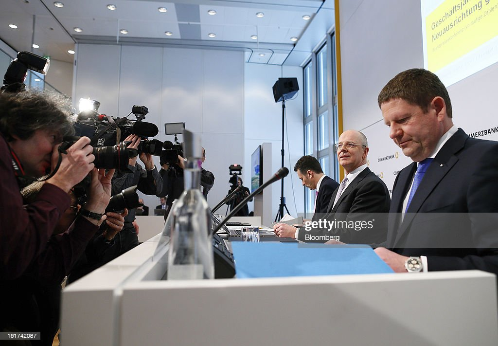 Martin Blessing, chief executive officer of Commerzbank AG, second right, and Stephan Engels, chief financial officer of Commerzbank AG, right prepare for a news conference in Frankfurt, Germany, on Friday, Feb.15, 2013. Blessing gave up his bonus for last year and cut the payouts by an average 17 percent across the firm, warning of higher costs and more pressure on revenue. Photographer: Ralph Orlowski/Bloomberg via Getty Images