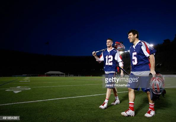 Martin Bowes and Jordan Burke of the Boston Cannons walk off of the field following their 146 win against the Charlotte Hounds at Harvard Stadium on...