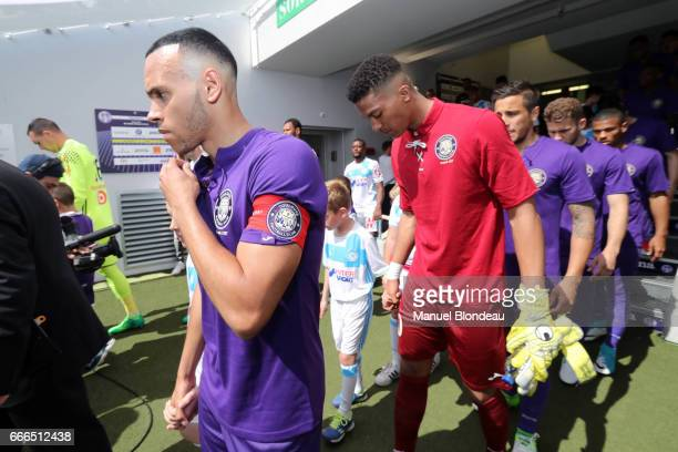 Martin Braithwaite and Alban Lafont of Toulouse during the Ligue 1 match between Toulouse FC and Olympique de Marseille at Stadium Municipal on April...