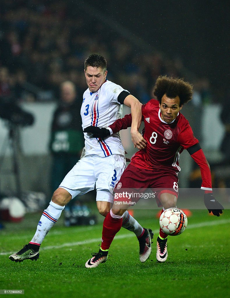 Martin Braithwaite of Denmark (r) holds off Haukur Heidar Hauksson of Iceland during the International Friendly match between Denmark and Iceland at the MCH Arena on March 24, 2016 in Herning, Denmark.