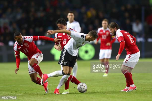 Martin Braithwaite of Denmark Thomas Delaney of Denmark Leon Goretzka of Germany battle for the ball during the international friendly match between...