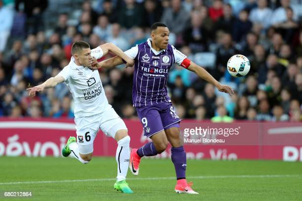Martin Braithwaite of Toulouse and Jonathan Delaplace of Caen during the Ligue 1 match between Toulouse FC and SM Caen at Stadium Municipal on May 6...