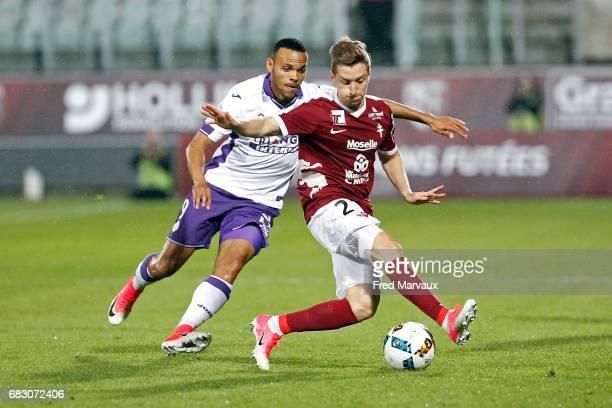 Martin Braithwaite of Toulouse and Yvan Balliu of Metz during the Ligue 1 match between FC Metz and Toulouse FC at Stade SaintSymphorien on May 14...