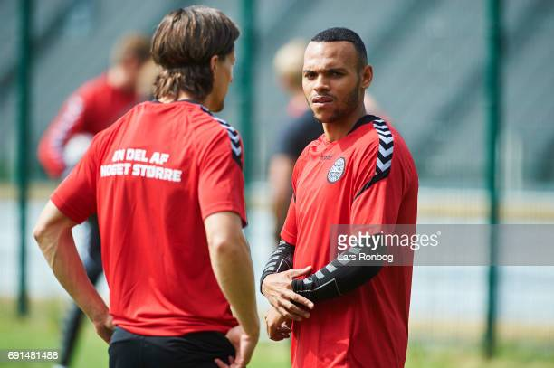 Martin Braithwaite speaks to Lasse Vibe prior to the Denmark training session at Brondby Stadion on June 2 2017 in Brondby Denmark