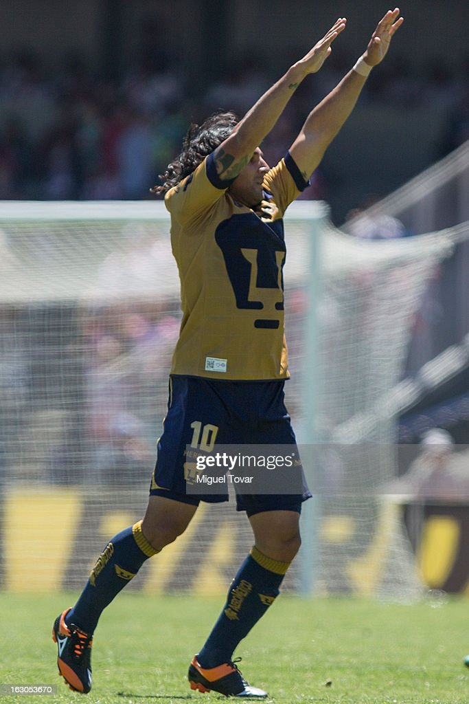 <a gi-track='captionPersonalityLinkClicked' href=/galleries/search?phrase=Martin+Bravo&family=editorial&specificpeople=5679185 ng-click='$event.stopPropagation()'>Martin Bravo</a> of Pumas, celebrates after scoring during a match between Pumas and Chivas as part of the Clausura 2013 at Olympic stadium on March 03, 2013 in Mexico City, Mexico.
