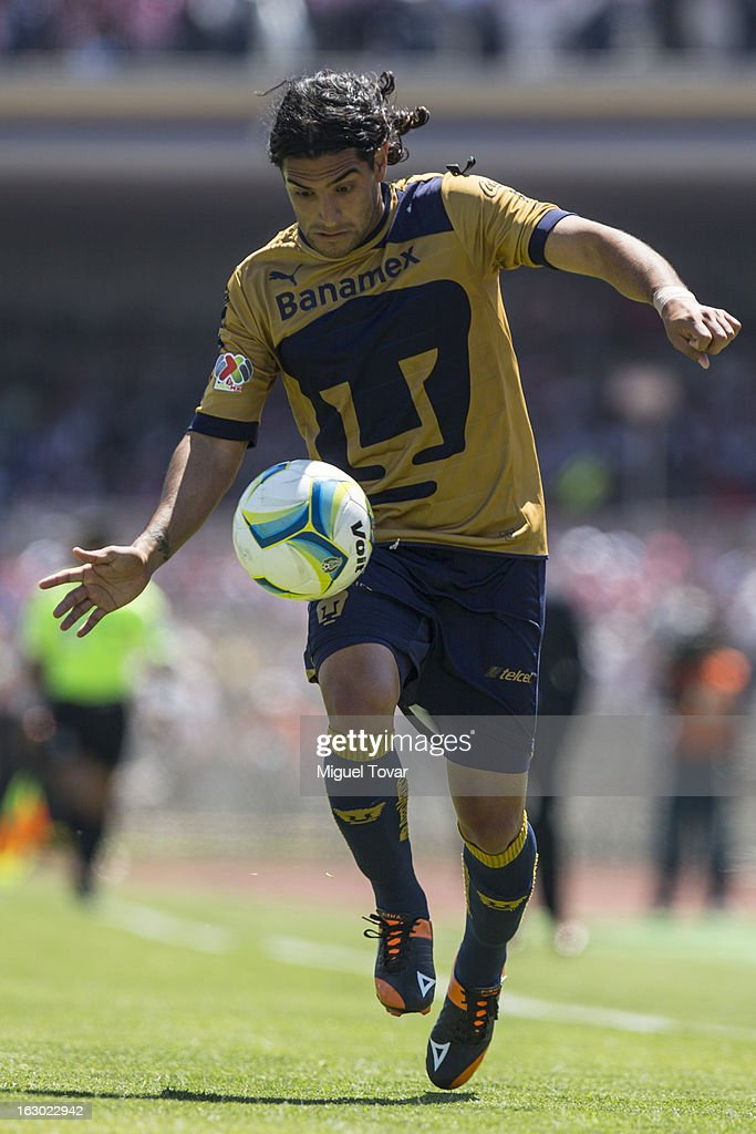 Martin Bravo of Pumas controls the ball during a match between Pumas and Chivas as part of Clausura 2013 Liga MX at Olympic Stadium on March 03, 2013 in Mexico City, Mexico.