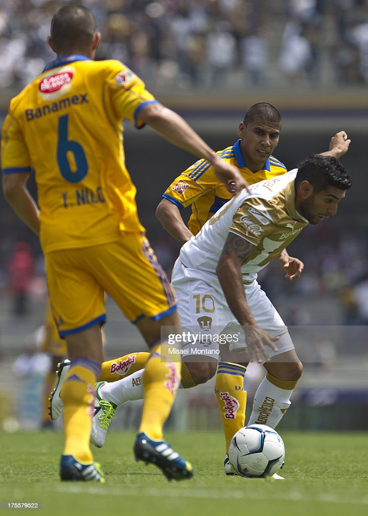 Martin Bravo of Pumas during a match between Pumas and Tigres as part of Torneo Apertura of Liga MX 2013 ar Olympic Stadium on August 04, 2013 in Mexico City, Mexico.