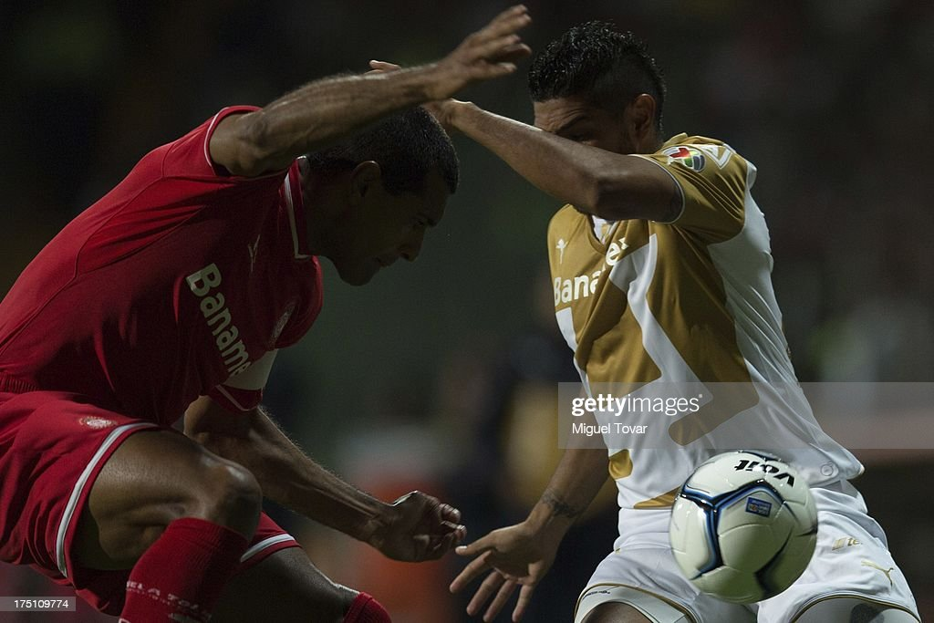 Martin Bravo of Pumas fights for the ball with Paulo da Silva of Toluca during a match between Toluca and Pumas as part of the Torneo Apertura 2013 Liga MX at Nemesio Siez stadium, on July 31, 2013 in Toluca, Mexico.