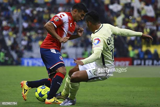 Martin Bravo of Veracruz struggles for the ball with Cecilio Dominguez of America during the 4th round match between America and Veracruz as part of...