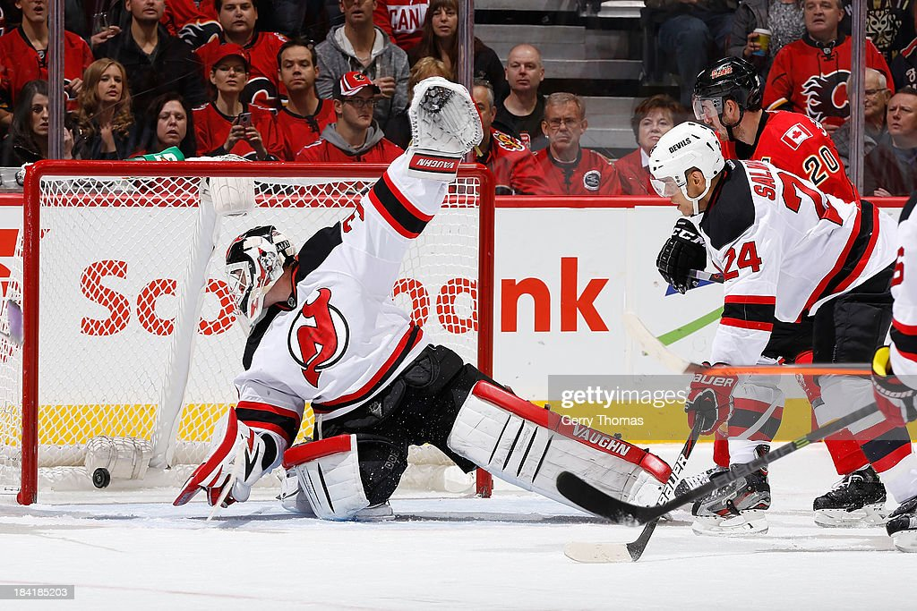 <a gi-track='captionPersonalityLinkClicked' href=/galleries/search?phrase=Martin+Brodeur&family=editorial&specificpeople=201594 ng-click='$event.stopPropagation()'>Martin Brodeur</a> #30 and <a gi-track='captionPersonalityLinkClicked' href=/galleries/search?phrase=Bryce+Salvador&family=editorial&specificpeople=208746 ng-click='$event.stopPropagation()'>Bryce Salvador</a> #24 of the New Jersey Devils can't make the stop on a shot assisted by <a gi-track='captionPersonalityLinkClicked' href=/galleries/search?phrase=Curtis+Glencross&family=editorial&specificpeople=2190970 ng-click='$event.stopPropagation()'>Curtis Glencross</a> #20 of the Calgary Flames at Scotiabank Saddledome on October 11, 2013 in Calgary, Alberta, Canada.