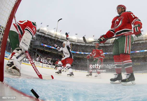Martin Brodeur and Stephen Gionta of the New Jersey Devils react to a second period goal by the New York Rangers during the 2014 Coors Light NHL...