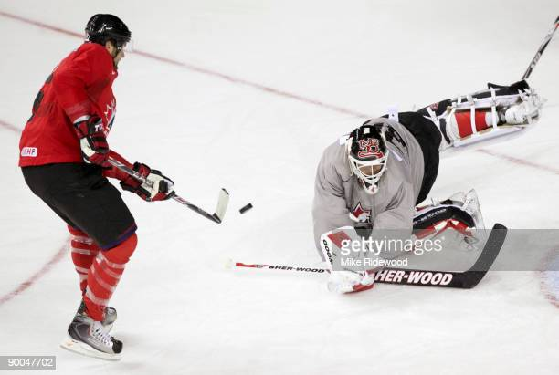 Martin Brodeur dives to make the save on Rick Nash during the second practice of the Team Canada Olympic Orientation Camp on August 24 2009 at the...
