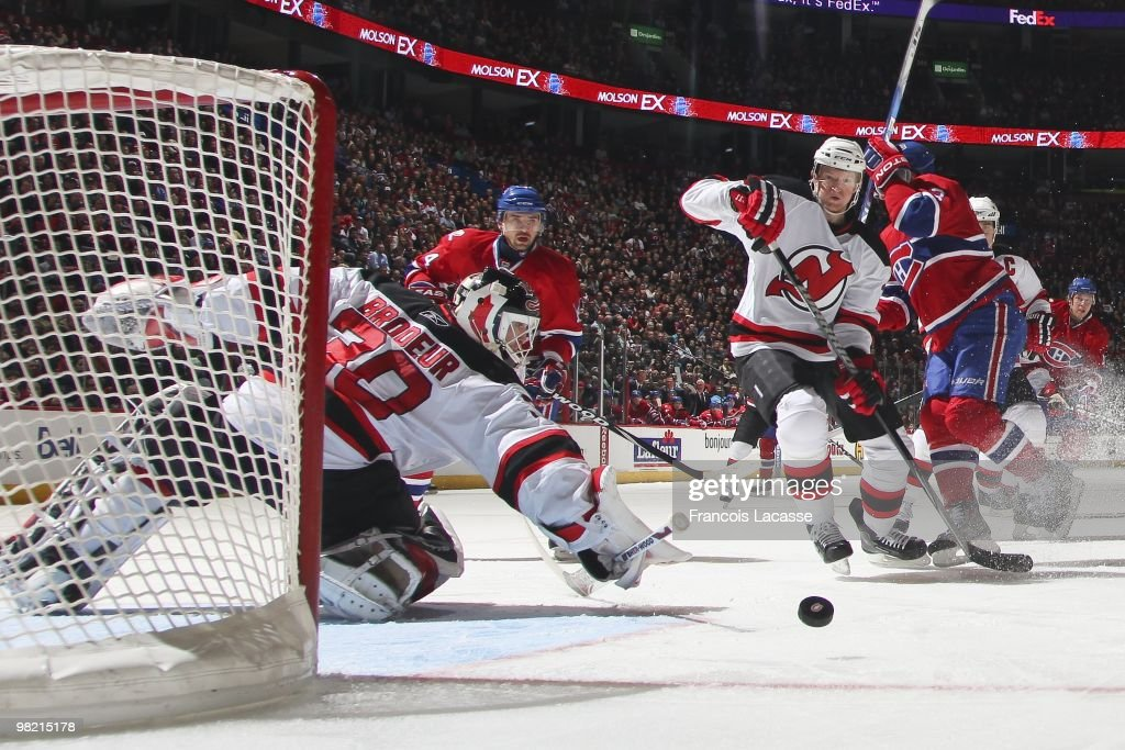 Martin Brodeur of New Jersey Devils blocks a shot of Tomas Plekanec of Montreal Canadiens during the NHL game on March 27 2010 at the Bell Center in...