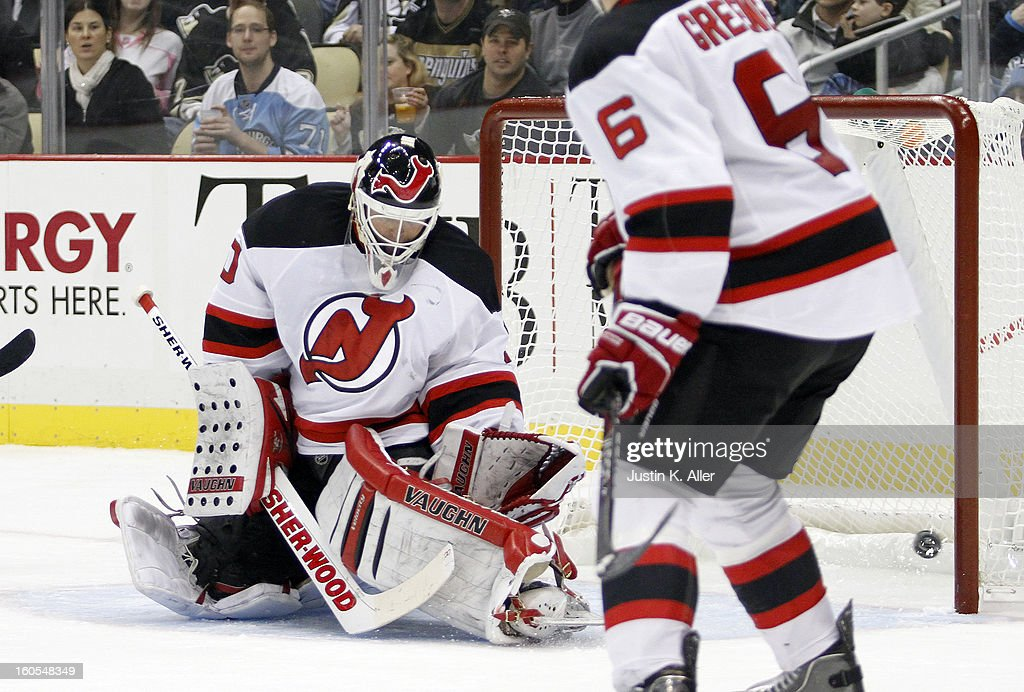 Martin Brodeur #30 of the New Jersey Devils can't stop a shot by Robert Bortuzzo #41 of the Pittsburgh Penguins in the third period during the game at Consol Energy Center on February 2, 2013 in Pittsburgh, Pennsylvania. The Penguins defeated the Devils 5-1.
