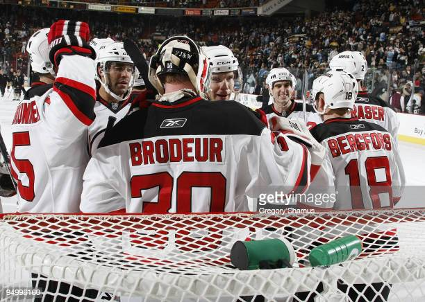 Martin Brodeur of the New Jersey Devils celebrates his 104th career shutout with teammates against the Pittsburgh Penguins on December 21 2009 at...