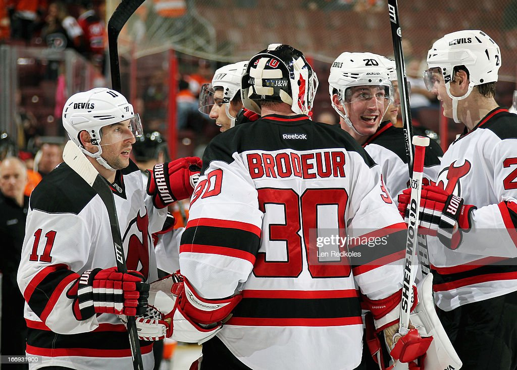 <a gi-track='captionPersonalityLinkClicked' href=/galleries/search?phrase=Martin+Brodeur&family=editorial&specificpeople=201594 ng-click='$event.stopPropagation()'>Martin Brodeur</a> #30 of the New Jersey Devils celebrates with his teammates after defeating the Philadelphia Flyers 3-0 on April 18, 2013 at the Wells Fargo Center in Philadelphia, Pennsylvania.