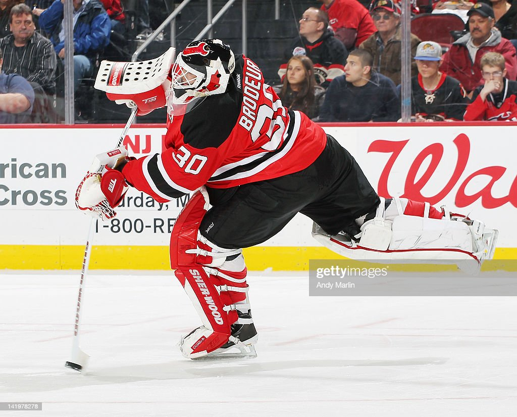 Martin Brodeur #30 of the New Jersey Devils clears the puck against the Chicago Blackhawks during the game at the Prudential Center on March 27, 2012 in Newark, New Jersey.