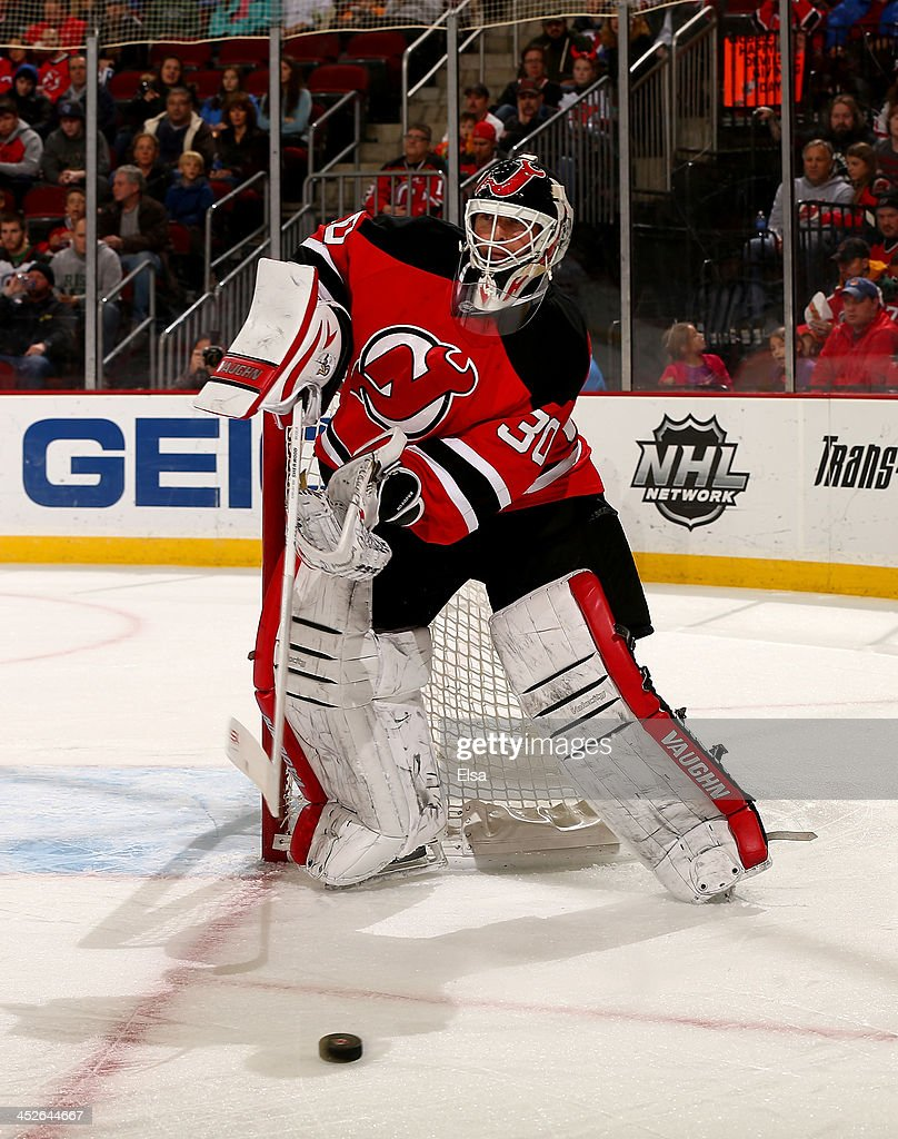 <a gi-track='captionPersonalityLinkClicked' href=/galleries/search?phrase=Martin+Brodeur&family=editorial&specificpeople=201594 ng-click='$event.stopPropagation()'>Martin Brodeur</a> #30 of the New Jersey Devils clears the puck in the first period against the Carolina Hurricanes at Prudential Center on November 27, 2013 in Newark, New Jersey.