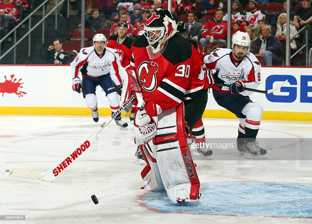 Martin Brodeur #30 of the New Jersey Devils clears the puck in the third period against the Washington Capitals at the Prudential Center on January 25, 2013 in Newark, New Jersey. The New Jersey Devils defeated the Washington Capitals 3-2 in overtime.