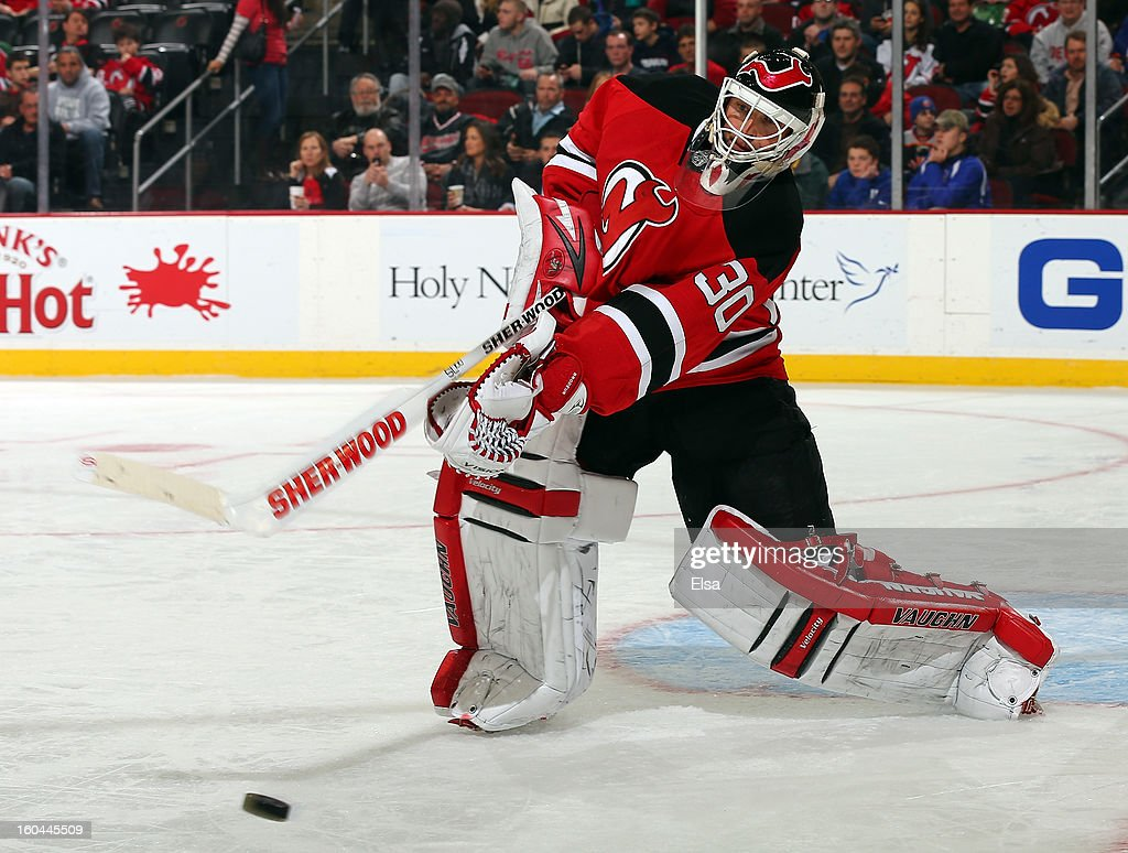 Martin Brodeur #30 of the New Jersey Devils clears the puck in the third period against the New York Islanders at the Prudential Center on January 31, 2013 in Newark, New Jersey.The New York Islanders defeated the New Jersey Devils 5-4 in overtime.