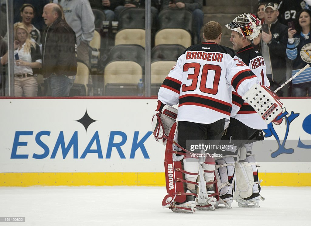 Martin Brodeur # 30 of the New Jersey Devils congratulates Johan Hedberg # 1 of the New Jersey Devils after the New Jersey Devils defeated the Pittsburgh Penguins 3-1 on February 10, 2013 at the CONSOL Energy Center in Pittsburgh, Pennsylvania.