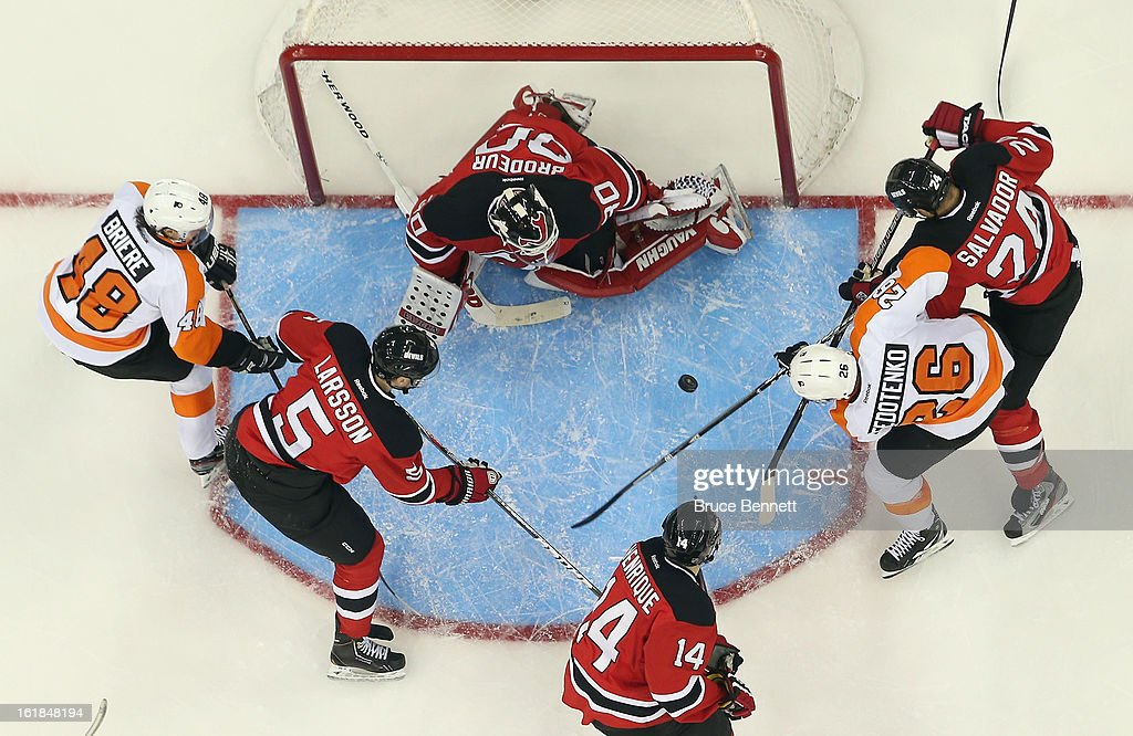 <a gi-track='captionPersonalityLinkClicked' href=/galleries/search?phrase=Martin+Brodeur&family=editorial&specificpeople=201594 ng-click='$event.stopPropagation()'>Martin Brodeur</a> #30 of the New Jersey Devils defends against the Philadelphia Flyers at the Prudential Center on February 15, 2013 in Newark, New Jersey.The Devils defeated the Flyers 5-3.