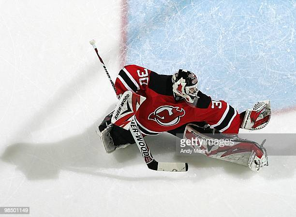 Martin Brodeur of the New Jersey Devils defends his goal against the Philadelphia Flyers in Game One of the Eastern Conference Quarterfinals during...
