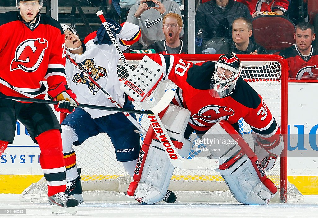 <a gi-track='captionPersonalityLinkClicked' href=/galleries/search?phrase=Martin+Brodeur&family=editorial&specificpeople=201594 ng-click='$event.stopPropagation()'>Martin Brodeur</a> #30 of the New Jersey Devils defends his net against <a gi-track='captionPersonalityLinkClicked' href=/galleries/search?phrase=Jonathan+Huberdeau&family=editorial&specificpeople=7144196 ng-click='$event.stopPropagation()'>Jonathan Huberdeau</a> #11 of the Florida Panthers at the Prudential Center on March 23, 2013 in Newark, New Jersey.