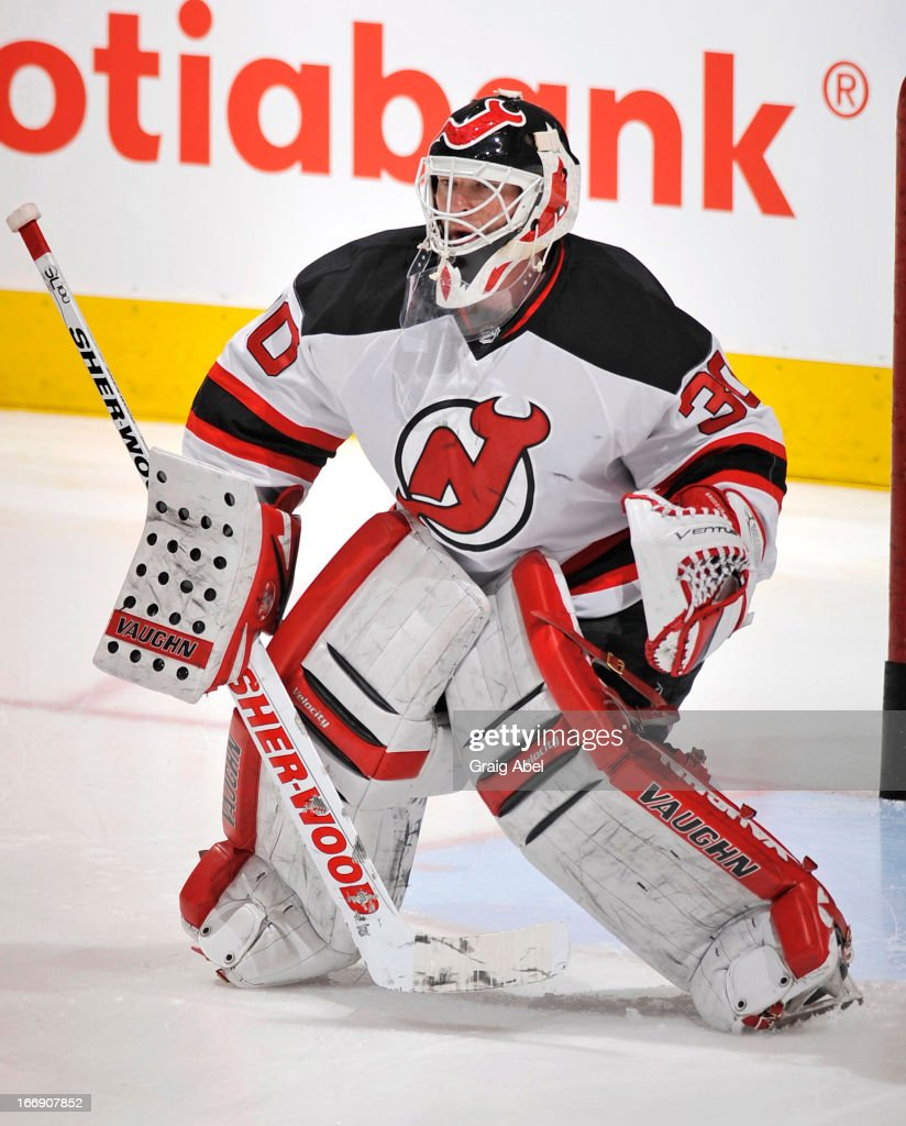 Martin Brodeur #30 of the New Jersey Devils defends the goal during warm up prior to NHL game action against the Toronto Maple Leafs April 15, 2013 at the Air Canada Centre in Toronto, Ontario, Canada.