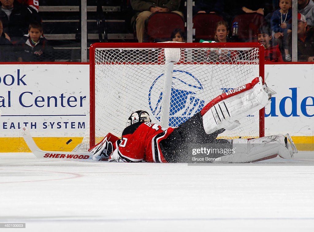 <a gi-track='captionPersonalityLinkClicked' href=/galleries/search?phrase=Martin+Brodeur&family=editorial&specificpeople=201594 ng-click='$event.stopPropagation()'>Martin Brodeur</a> #30 of the New Jersey Devils deflects a puck away from the net against the Winnipeg Jets at the Prudential Center on November 25, 2013 in Newark, New Jersey. The Jets defeated the Devils 3-1.