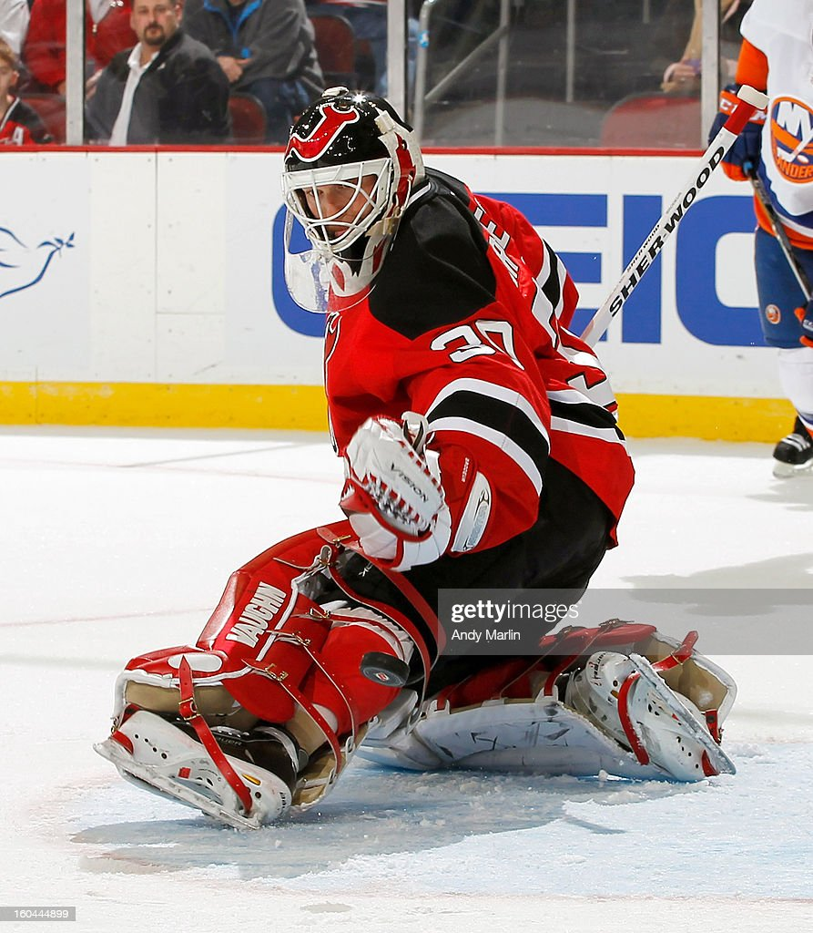 Martin Brodeur #30 of the New Jersey Devils deflects the puck with his skate against the New York Islanders during the game at the Prudential Center on January 31, 2013 in Newark, New Jersey.