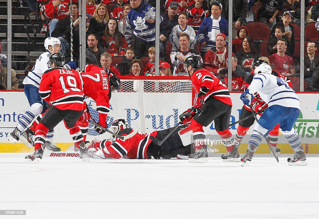Martin Brodeur #30 of the New Jersey Devils dives to defend his net against the Toronto Maple Leafs during the game at the Prudential Center on April 6, 2013 in Newark, New Jersey.