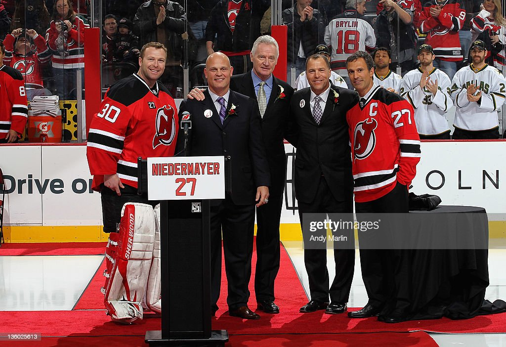 Martin Brodeur #30 of the New Jersey Devils, former Devil Ken Daneyko, assistant coach Larry Robinson, former Devil Scott Stevens, and former Devil Scott Niedermayer pose for a photo during the retirement ceremony of Niedermayer's jersey number 27 prior to the game between the Dallas Stars and the New Jersey Devils at the Prudential Center on December 16, 2011 in Newark, New Jersey.