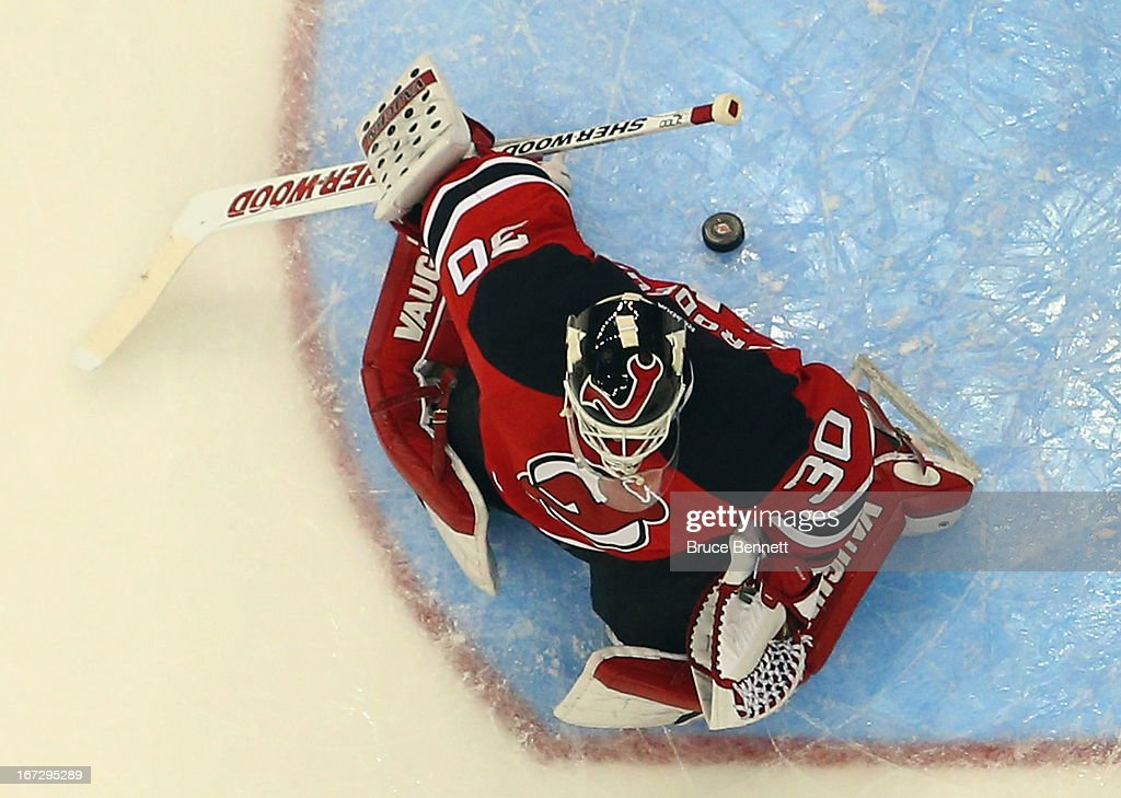 <a gi-track='captionPersonalityLinkClicked' href=/galleries/search?phrase=Martin+Brodeur&family=editorial&specificpeople=201594 ng-click='$event.stopPropagation()'>Martin Brodeur</a> #30 of the New Jersey Devils has a puck sneak behind him in the game against the Montreal Canadiens at the Prudential Center on April 23, 2013 in Newark, New Jersey. The Devils defeated the Canadiens 3-2.