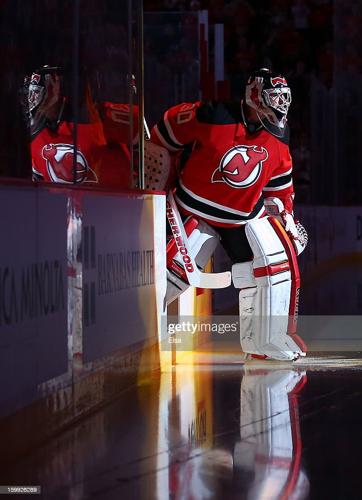 Martin Brodeur #30 of the New Jersey Devils heads onto the ice for player introductions before the game against the Philadelphia Flyers during the season opener at the Prudential Center on January 22, 2013 in Newark, New Jersey.