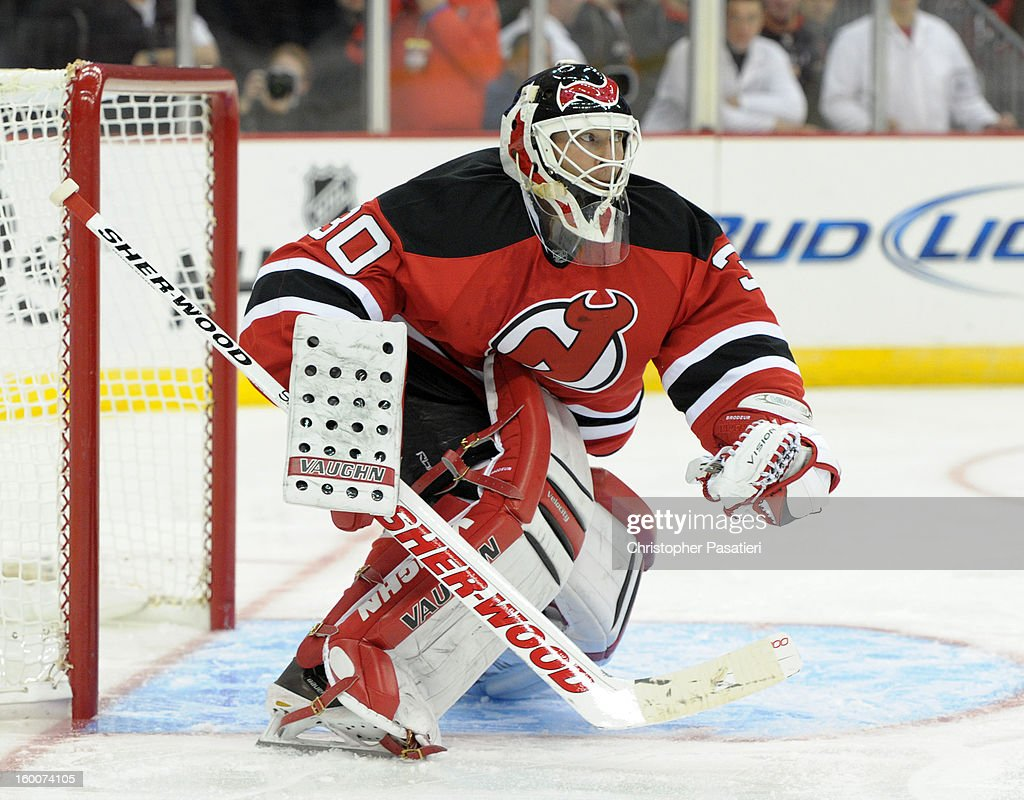 Martin Brodeur #30 of the New Jersey Devils holds on to the puck after a save against the Washington Capitals on January 25, 2013 at the Prudential Center in Newark, New Jersey.