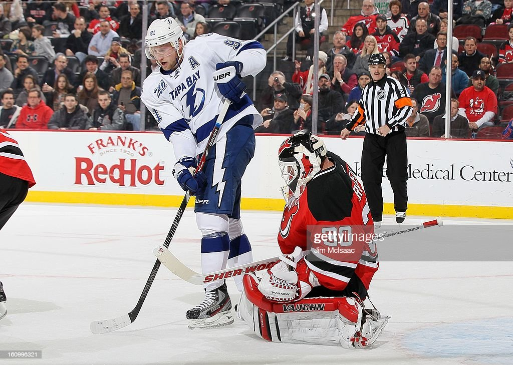 Martin Brodeur #30 of the New Jersey Devils in action against Steven Stamkos #91 of the Tampa Bay Lightning at the Prudential Center on February 7, 2013 in Newark, New Jersey. The Devils defeated the Lightning 4-2.