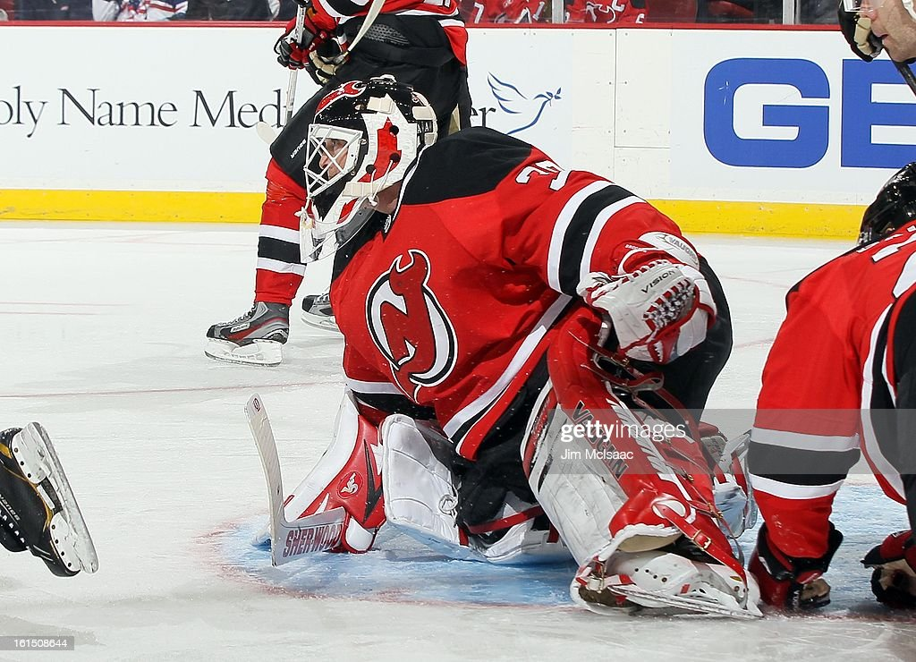 Martin Brodeur #30 of the New Jersey Devils in action against the Pittsburgh Penguins at the Prudential Center on February 9, 2013 in Newark, New Jersey. The Devils defeated the Penguins 3-1.