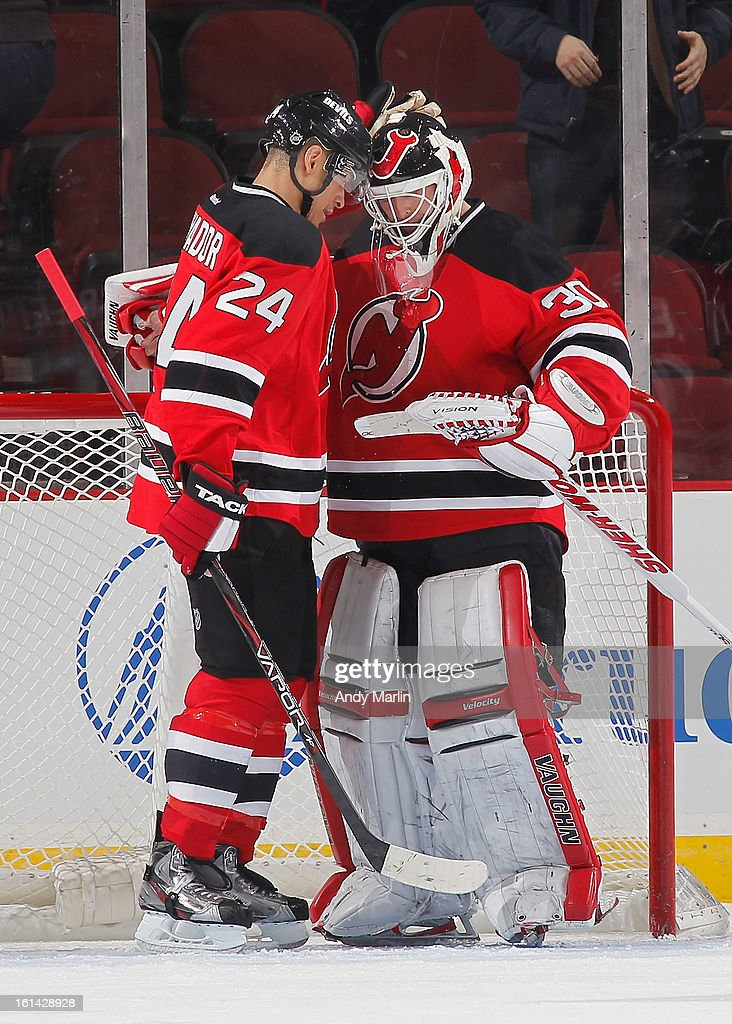 Martin Brodeur #30 of the New Jersey Devils is congratulated by Bryce Salvador #24 after defeating the Pittsburgh Penguins in his 1200th career NHL regular season game at the Prudential Center on February 9, 2013 in Newark, New Jersey.
