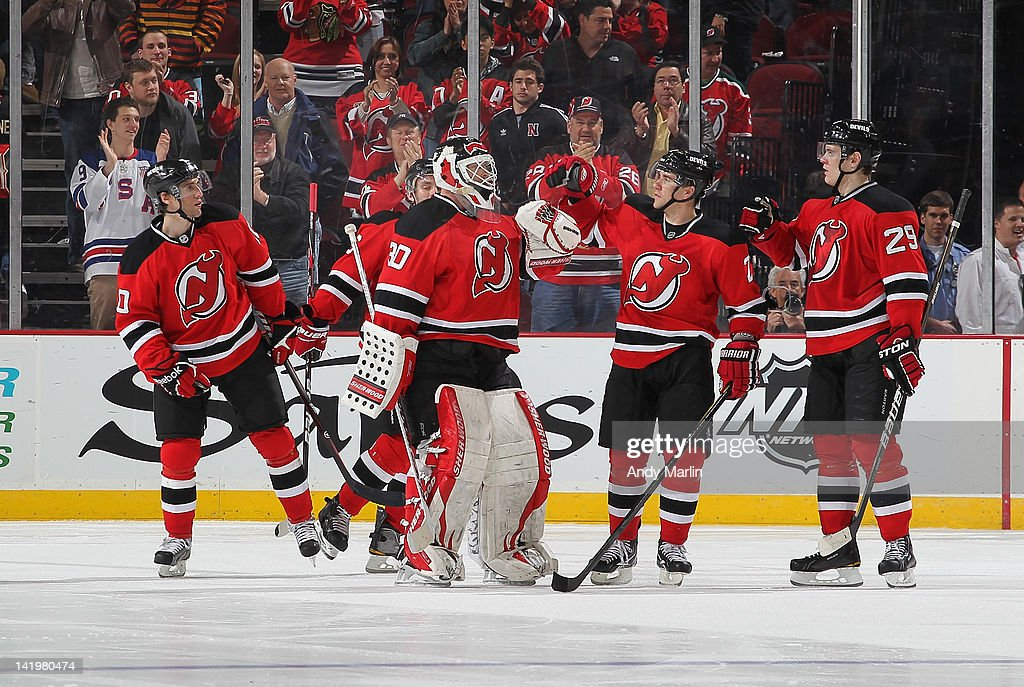 Martin Brodeur #30 of the New Jersey Devils is congratulated by his teammates after defeating the Chicago Blackhawks in a shootout at the Prudential Center on March 27, 2012 in Newark, New Jersey. The Devils defeated the Blackhawks 2-1 in a shootout.