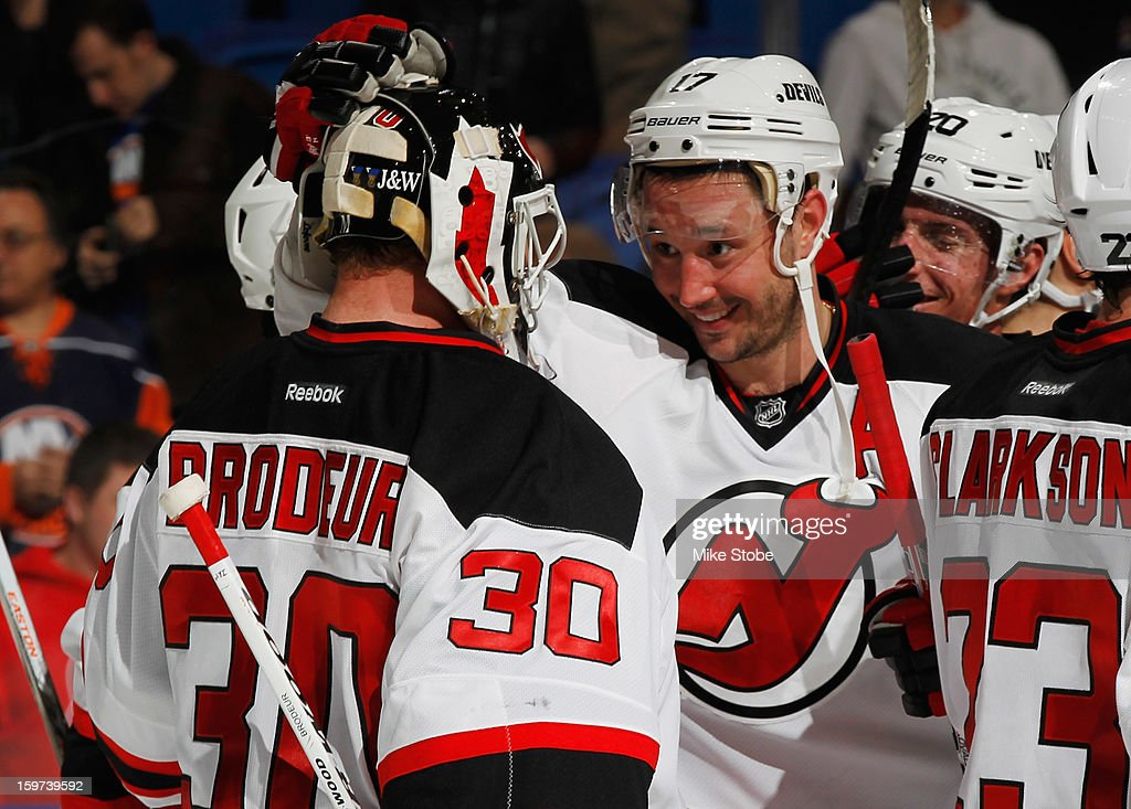 Martin Brodeur #30 of the New Jersey Devils is congratulated by teammate Ilya Kovalchuk #17 on their win against the New York Islanders at Nassau Veterans Memorial Coliseum on January 19, 2013 in Uniondale, New York. The Devils defeated the Islanders 2-1.