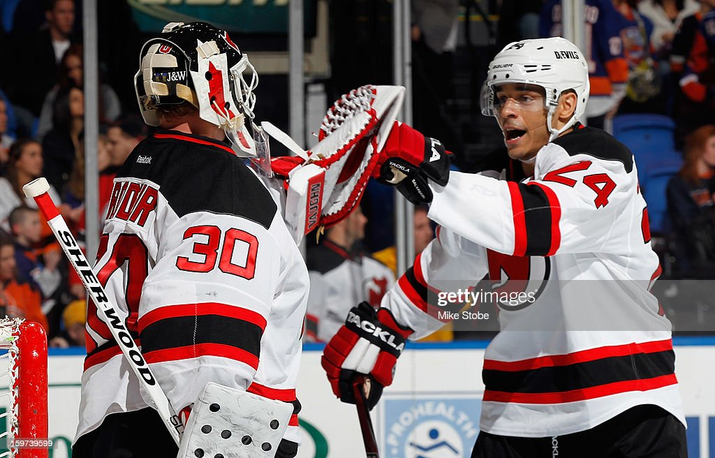 Martin Brodeur #30 of the New Jersey Devils is congratulated by teammate Bryce Salvador #24 on their win against the New York Islanders at Nassau Veterans Memorial Coliseum on January 19, 2013 in Uniondale, New York. The Devils defeated the Islanders 2-1.