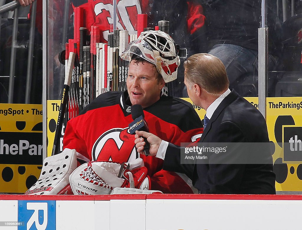 Martin Brodeur #30 of the New Jersey Devils is interviewed after acheiving his NHL record 120th shutout against the Philadelphia Flyers at the Prudential Center on January 22, 2013 in Newark, New Jersey.